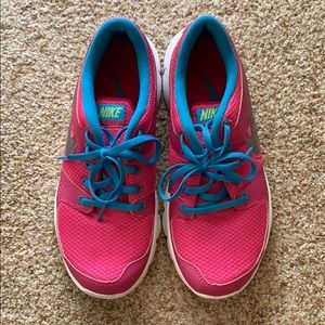 Pink and blue Nike tennis shoes women's size 8.5